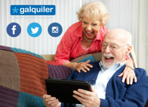 Senior couple laughing while using their tablet pc to video chat with their grandkids.